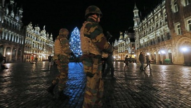Belgian soldiers patrol on the Grand Place of Brussels as police searched the area during a continued high level of security following the recent deadly Paris attacks in Brussels