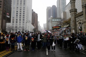 Demonstrators link arms during a protest intending to disrupt Black Friday shopping in reaction to the fatal shooting of Laquan McDonald in Chicago