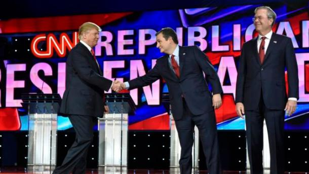 Republican U.S. presidential candidate businessman Donald Trump (L) shakes hand with Senator Ted Cruz as he arrives onstage with Cruz and former Governor Jeb Bush before the start of the Republican presidential debate in Las Vegas
