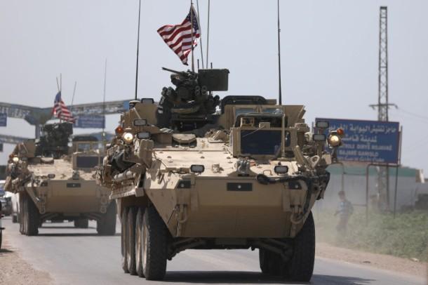 U.S military vehicles travel in the northeastern city of Qamishli